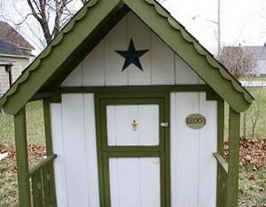 Address plate hung on kids playhouse
