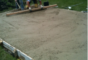 Level the concrete for the kids playhouse