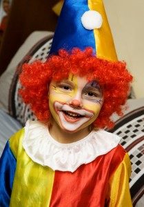 Child is a clown at a kids playhouse