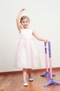 Ballerina in a kids playhouse